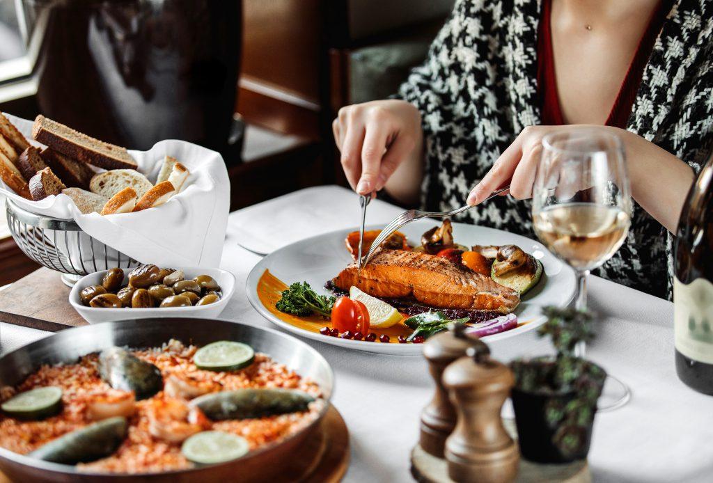 women-eating-fish