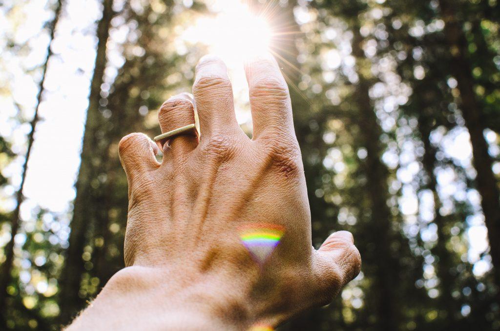 men reaching for sun reiki effects