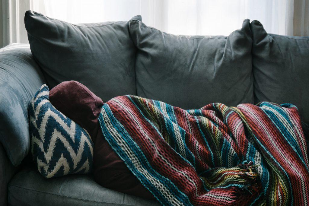 men sleeping in couch