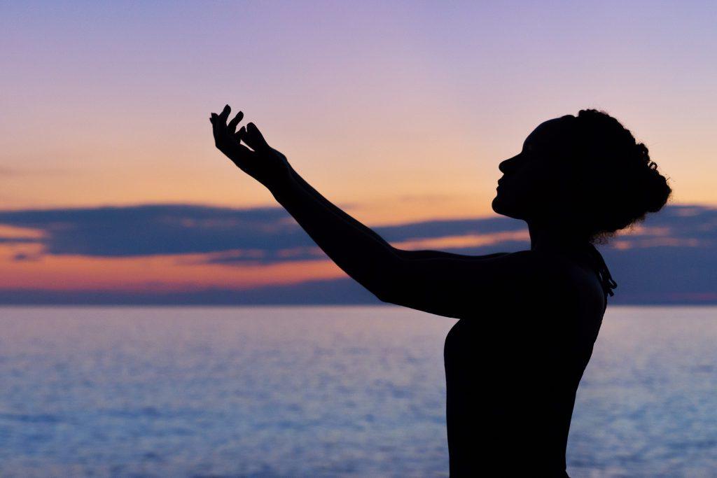 women healing in beach reiki healing process